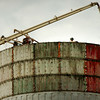 Salisbury: Workers aim a pump putting concrete into forms atop the new water tower at Salisbury Beach. Bryan Eaton/Staff Photo