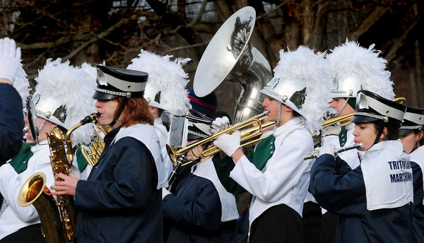 West Newbury: The Triton and Pentucket High School bands teamed up to play the National Anthem at the start of the school's Thanksgiving Day football game. Bryan Eaton/Staff Photo