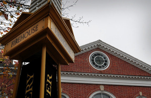 Newburyport: The clock atop the Firehouse Center is back in place after restoration. Bryan Eaton/Staff Photo