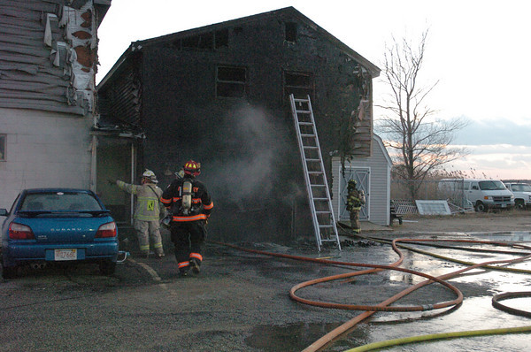 Salisbury: Firefighters quickly put out a fire at this apartment at Salisbury Beach behind the old Mr. K's Lounge on North End Boulevard on Saturday afternoon. Bryan Eaton/Staff Photo