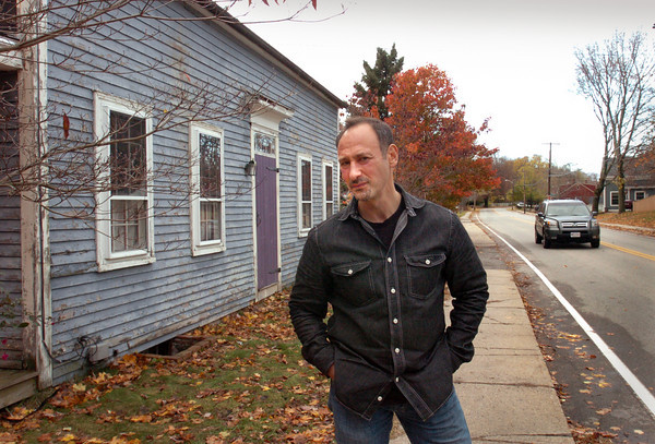 Amesbury: Paul Sullivan, outside his Main Street home, is appealing his Amesbury tax assessment, which is based on a higher property value because it is considered a historic structure. Bryan Eaton/Staff Photo