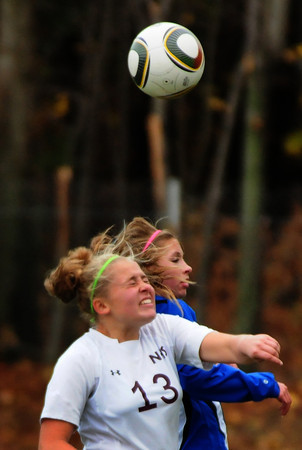 Newburyport: Newburyport's Elena Robidoux, left, clashes with a Bedford player yesterday at Cherry Hill Field. Bryan Eaton/Staff Photo