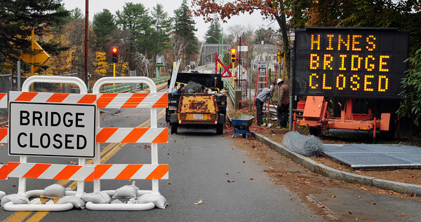 Amesbury: A work crew installs chainlink fencing at the Hines Bridge which closed on Monday for the 18-month rebuilding project. Signs are in place to divert traffic through Salisbury Square and over Interstate 95. Bryan Eaton/Staff Photo