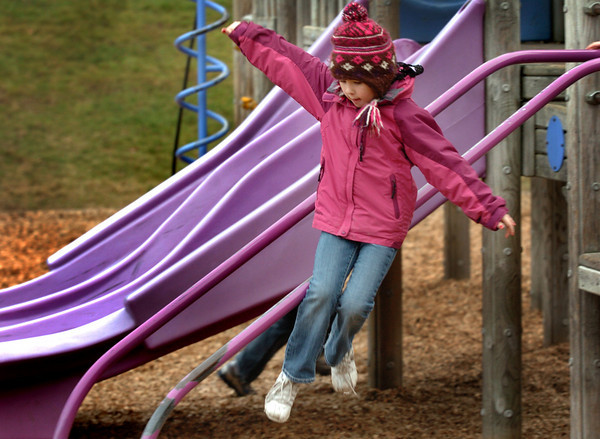 Amesbury: Emma Porter, 6, jumps off some playground equipment, not quite sliding to the bottom Monday afternoon. She was in the Amesbury Recreation Department's Afterschool Program at the Amesbury Elementary School. Bryan Eaton/Staff Photo