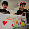 Newbury: Newbury Elementary School students Cameron Lebrecque, 9, left, and Thomas Marshall, 10, decorate boxes to be filled with Thanksgiving food Thursday afternoon. They and about 20 other classmates packed the food that was collected throughout the school and are distributing 50 boxes to the Pettengill House and 25 to the senior center, located in the school. Bryan Eaton/Staff Photo