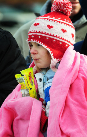 West Newbury: Sarina Viselli, 7, of Rowley was bundled up against the cold weather at the Triton at Pentucket football game Thursday. She was there to watch her brother, Bob, who plays for Triton. Bryan Eaton/Staff Photo