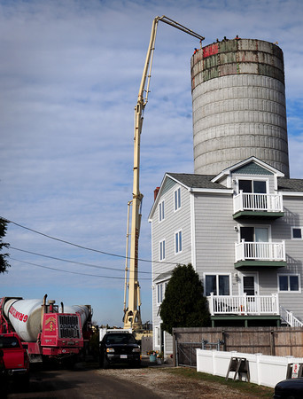Salisbury: Concrete is pumped up the top of the new water tower at Salisbury Beach. Bryan Eaton/Staff Photo