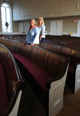 Amesbury: Rev. Joan MacPherson, left, and Lori Townsend, publicity chair of the building campaign, show off the renovated inside of the Main Street Congregational Church in Amesbury. The exterior has been painted, the inside has been cleaned and painted, a new rug put in, the pews refinished and laid with cushioned seating. Bryan Eaton/Staff Photo