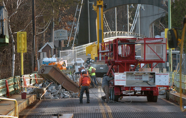 Amesbury: Work crews break up parts of the Hines Bridge sidewalk on Monday as demolition of the structure gets underway. Bryan Eaton/Staff Photo