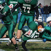 West Newbury: Triton'sJoe Ruocco tackles Pentucket's Paul Treado as Sean Brennan block's Triton's Billy Murphy. Bryan Eaton/Staff Photo