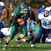 West Newbury: Pentucket's Jeremy Krugh goes for yardage past Triton's Jedd Hutchins. Bryan Eaton/Staff Photo