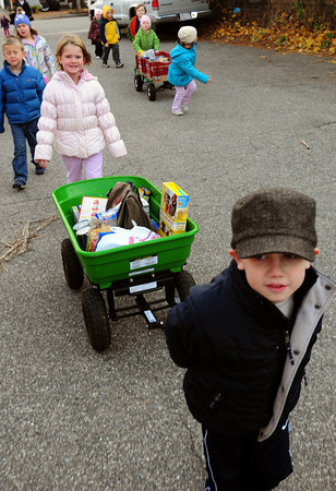 Newburyport: Ian Hynes, 5, leads the caravan of his kindergarten classmates from the Brown School in Newburyport on their way to the Salvation Army. The youngsters collected non-perishable food item for the agency's food pantry. Bryan Eaton/Staff Photo