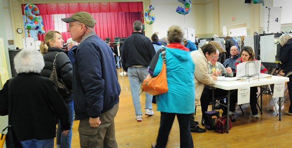 Amesbury: Voting was very steady around lunchtime yesterday at Amesbury Town Hall. Bryan Eaton/Staff Photo