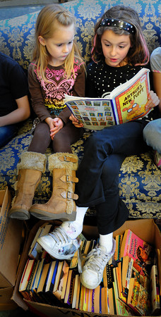 Salisbury: Summer Noonan, right, reads Arthur's New Puppy with Marirose Waterson, both 7, Tuesday afternoon. They were in the new reading room at the Boys and Girls Club in Salisbury. Bryan Eaton/Staff Photo