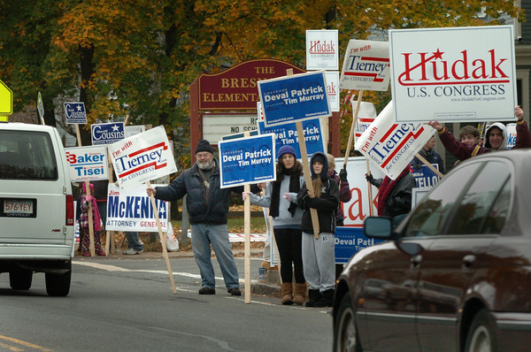 Newburyport: Political supporters were holding signs touting their candidates yesterday morning at the Bresnahan School in Newburyport. Bryan Eaton/Staff Photo