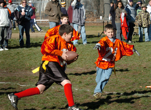 Salisbury: Mike Velardocchia runs for a touchdown with an interception at the annual Williams Bowl football game at Salisbury Elementary School on Wednesday morning. Velardocchia's team, the Dolphins, beat Boise State. Bryan Eaton/Staff Photo