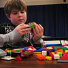 Amesbury: Liam Healy, 10, works with Lego's at the Amesbury Rec. Department's Afterschool Program at Amesbury Elemtary School yesterday. He starts out making something, in this case a turtle, then ends up with automobiles or airplanes. Bryan Eaton/Staff Photo