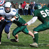 West Newbury: Triton's Derek Paquette breaks through some Pentucket defenders at the Thanksgiving Day game. Bryan Eaton/Staff Photo