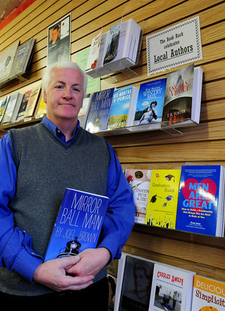 "Newburyport: Steve Des Lauriers, manager of The Book Rack, sells some self-published works like local author Joel Brown's ""Mirror Ball Man."" Bryan Eaton/Staff Photo"