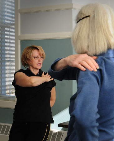 West Newbury: Yoga Instructor is Mary VanAbs teaches a class at the 1910 Building in West Newbury. Bryan Eaton/Staff Photo