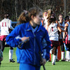 Amesbury: Newburyport field hockey team celebrates, back, as Georgetown players leave the field yesterday afternoon. The Clippers defeated Georgetown 2-0 at Amesbury Sports Park. Bryan Eaton/Staff Photo