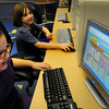 Salisbury: Abbrielle Carrera, 8, left, of Salisbury and Cheylan Meader, 7, of Amesbury, play a game of Moshi Monsters in the education room at the Boys and Girls Club on Monday. The game is a brand new online game where you can adopt your very own pet monster, each one having a lively, unique personality. Bryan Eaton/Staff Photo