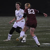 Lynn: Georgetown's Madeleine Duncan defends Weston's Anna Duffy during their game at Manning Field in Lynn Thursday night. Jim Vaiknoras/Staff photo