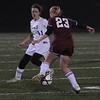 Lynn: Georgetown's Madeleine Duncan defends Weston's Anna Duffy during their game at Manning Field in Lynn Thursday night. Jim Vaiknoras/Staff photo