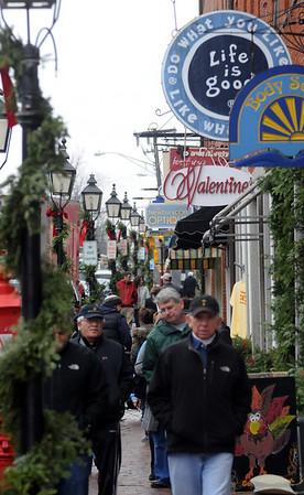 Newburyport: Despite the wet weather, shopper crowd State Street in Newburyport Friday looking for gifts. Jim Vaiknoras/Staff photo