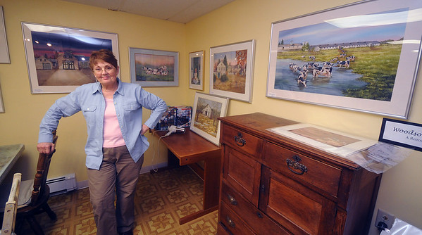 Amesbury:Joan Gessner'stands with her watercolor retrospective of Woodsom Farm through the years.Her  studio will be showcased this weekend as an official stop on the Amesbury Studio Tour, taking place Friday evening, Saturday and Sunday.  JIm Vaiknoras/Staff photo