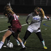 Lynn: Georgetown's Nicoline Holland knocks the ball away from 2 Weston players  during their game at Manning Field in Lynn Thursday night. Jim Vaiknoras/Staff photo