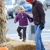 Newburyport: Cady Seaton, 2, of West Newbury, and her mom Erin enjoy a cold autumn morning in Market Square in Newburyport. Jim Vaiknoras/Staff photo