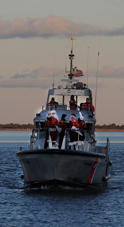 Newburyport: The Coast Guard brings Santa and Mrs Claus to the Newburyport Waterfront for the annual Christmas Tree Lighting in Market Square Sunday. Jim Vaiknoras/Staff photo
