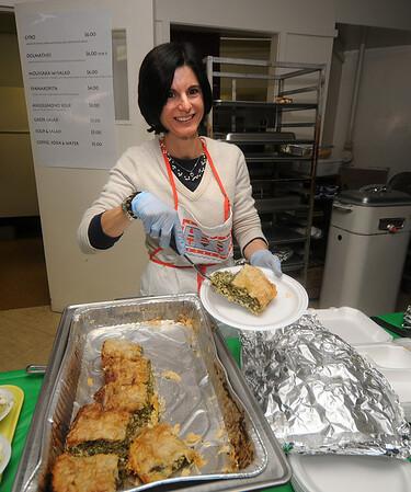 Newburyport: Joanna Tsiantas serves spanakupita at the Greek Ladies Aid Association third annual Greek luncheon and holiday fair at the Greek Church in Newburyport. Jim Vaiknoras/Staff photo