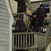 Salisbury: Fire fighter inspect the scene of Saturday's fire in Salisbury: Jim Vaiknoras/Staff photo