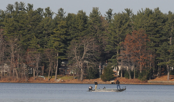 Merrimac: A pair of fishermen enjoy a sunny and cold day on Lake Attitash Sunday afternoon. Jim Vaiknoras/Staff photo