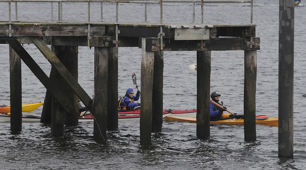 Newburyport: Kayakers make their way by the old peir at Cashman Park in Newburyport on a cold Sunady morning. Jim Vaiknoras/Staff photo