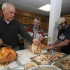 Byfield: Bob True, Lenny Boudreau, Ken Bower carve up 2 of the 8 turkeys they served at Byfield Community United Methodist Church Thanksgiving dinner Sunday at the church. Jim Vaiknoras/Staff photo