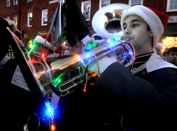 Newburyport: Christian Gray plays a festively lit tenor horn with the Triton band at the annual Christmas Tree Lighting in Market Square in Newburyport Sunday night. Jim Vaiknoras/Staff photo