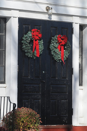 Amesbury: A pair of weaths decorate the doors of the Union Congragational Church in Amesbury welcoming the Christmas Season. Jim Vaiknoras/Staff photo