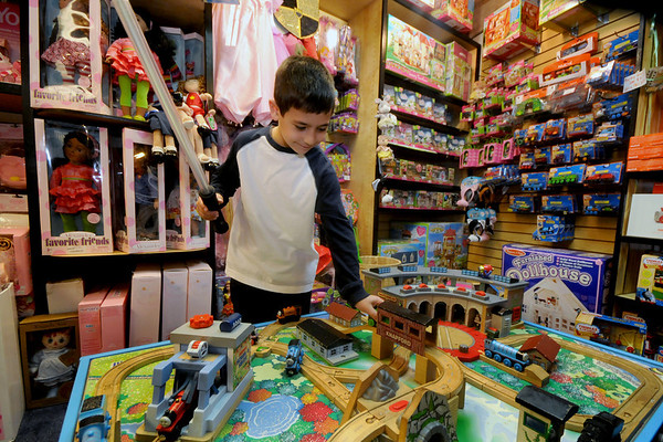 Newburyport: Michael Ranieri, 7,  holds a light saber while looking over the Thmas the Train display at the Dragon's Nest in Newburyport Friday afternoon. Jim Vaiknoras/Staff photo