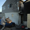 Salisbury: Residents move items from the scene of Saturday fire in Salisbury: Dave Rogers/Staff photo