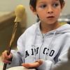 Amesbury: Timmy George, a student in Joanna Dodiers kindergarten at the Cashman School in Amesbury plays the drum in Mary Krikorian's music class Thurday. Jim Vaiknoras/Staff photo