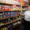Newburyport: Major Kathy Purvis of the Newburyport Salvation Army looks over the pantry at the Salvation Army's Water Street location. Jim Vaiknoras/Staff photo