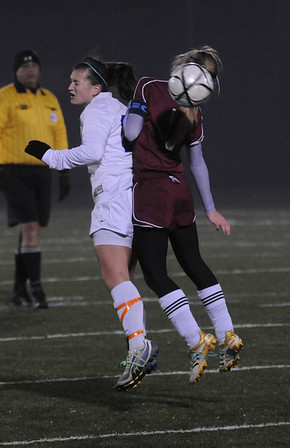 Lynn: Georgetown's Kelly Chickering goes up for the ball with a Weston player during their game at Manning Field in Lynn Thursday night. Jim Vaiknoras/Staff photo
