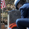 Salisbury: Lt Tyana Thayer places a Coast Guard flag at the grave of John J Kohan following a ceremony at Longhill Cemetary in Salisbury Thursday.Kohan was kill in a helecopter crash in 1956 JIm Vaiknoras/Staff photo
