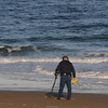 salisbury : A treasure hunter searches Salisbury Beach with a metal detector Sunday morning. JIm Vaiknoras/Staff photo