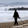 Newbury: Ronnie Davies uses a metal detector on Plum Island Sunday morning. Jim Vaiknoras/Staff photo