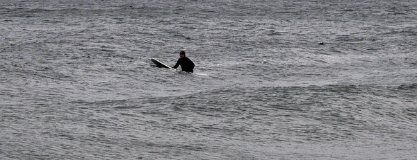 Salisbury: A lone surfer waits patiently for a wave off Salisbury Beach on a cold Sunday morning. Jim Vaiknoras/Staff photo