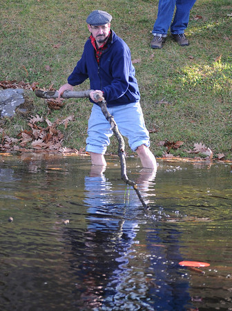 Amesbury: Tom Duff of Essex braves the cold water at Amesbury Park to retreave a golf disc Sunday afternoon. The small pond had a bit of ice forming around the edge. The off target disc was thrown by his son and cost about $8. Jim Vaiknoras/Staff photo